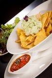 Crisp corn nachos with guacamole sauce Stock Photos