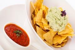 Crisp corn nachos with guacamole sauce Stock Images