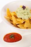 Crisp corn nachos with guacamole sauce Royalty Free Stock Photo