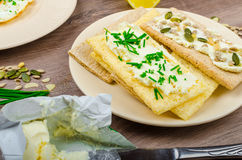 Crisp Crispbread with cheese spread with chives and Crisp Crispbread with curd cheese spread chives and seeds Royalty Free Stock Images
