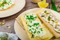 Crisp Crispbread with cheese spread with chives and Crisp Crispbread with curd cheese spread chives and seeds Royalty Free Stock Photo
