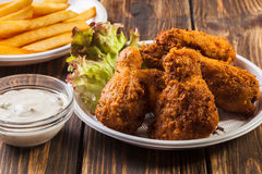 Crisp crunchy chicken wings with chips Royalty Free Stock Photography