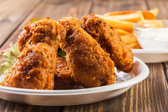 Crisp crunchy chicken wings with chips Stock Photography