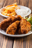 Crisp crunchy chicken wings with chips Stock Images