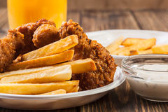 Crisp crunchy chicken wings with chips Stock Image