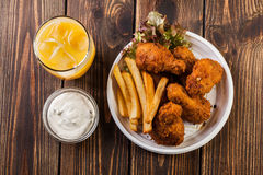 Crisp crunchy chicken wings with chips Stock Photo