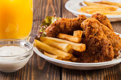 Crisp crunchy chicken wings with chips Royalty Free Stock Images