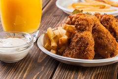 Crisp crunchy chicken wings with chips Royalty Free Stock Photos