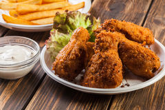Crisp crunchy chicken wings with chips Royalty Free Stock Image