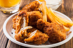 Crisp crunchy chicken wings with chips Royalty Free Stock Photo