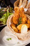 Crisp crunchy golden chicken legs and wings Royalty Free Stock Photography
