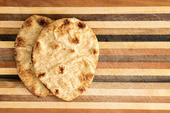 Crisp crusty naan whole grain flatbread Royalty Free Stock Photos