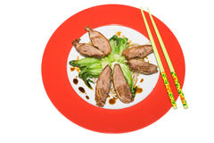 Crisp duck with baby pok choi Royalty Free Stock Photo