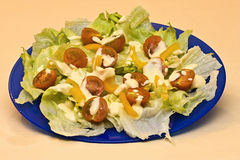 Crisp and fresh salad on plate with dressing. Tasty crisp salad on plate with dressing ,fresh vegetable Stock Image