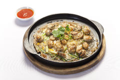 Crisp fried oyster pancake in hot plate Royalty Free Stock Photo
