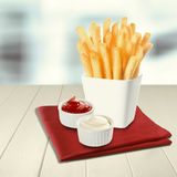 Crisp fried potato batons or chips Royalty Free Stock Photo