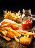 Crisp golden battered fried fish with chips stock photography