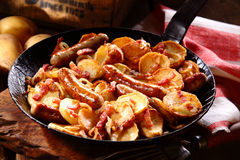Crisp golden potato with frankfurters and bacon Stock Photo