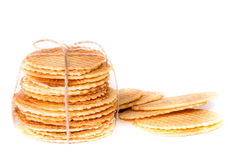 Crisp golden waffle wafer biscuits. Used for garnishing desserts on a white background Stock Photo