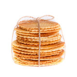 Crisp golden waffle wafer biscuits. Used for garnishing desserts on a white background Royalty Free Stock Photos