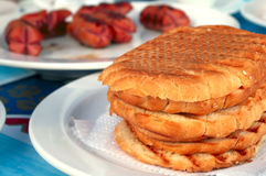 Crisp hot toast and grilled sausages. Breakfast with crisp hot toast and grilled sausages royalty free stock photos