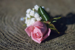 Crisp pink rose and wildflowers small bouquet for buttonhole Royalty Free Stock Image