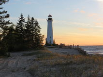 Crisp Point Lighthouse Sunrise. Crisp Point Lighthouse which guards the entrance to Whitefish Bay on Lake Superior stands as a beacon on the remote coast Royalty Free Stock Image
