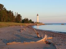 Crisp Point Lighthouse Sunset. Crisp Point Lighthouse which guards the entrance to Whitefish Bay on Lake Superior stands as a beacon on the remote coast Royalty Free Stock Photo