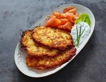 Crisp Potato Rosti, Smoked Salmon and Dill Sauce Royalty Free Stock Images