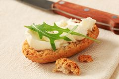 Crisp roll with cheese spread Stock Photos