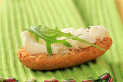 Crisp roll with cheese spread Royalty Free Stock Photo