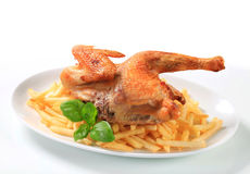 Crisp-skinned chicken with French fries Royalty Free Stock Images