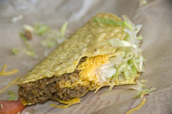 Crisp Taco. A taco after a few bites stock photo