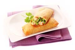 Crisp Vegetable Spring Rolls on White Dish Stock Images