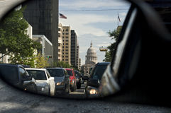 Crisp view of Texas capitol building from car mirror. The Texas capitol building and Congress Ave as seen in a car rear view mirror Royalty Free Stock Image