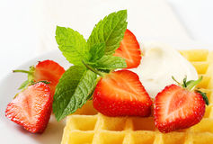 Crisp waffle with fresh strawberries Stock Photos