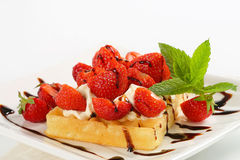 Crisp waffle with  strawberries and cream Royalty Free Stock Image