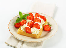 Crisp waffle with  strawberries and cream Royalty Free Stock Photos