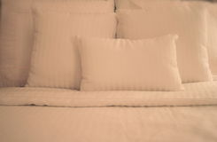 Crisp White Sheets on Bed stock image