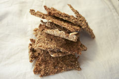 Crispbread. A stack of fresh home made crispbread full of whole grain royalty free stock photos