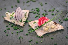 Crispbread appetizers on slate plate stock photography