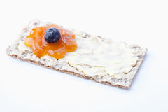 Crispbread with butter and flower shaped apricot jam Royalty Free Stock Photography