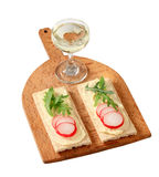 Crispbread with butter, radish and arugula. Crispbread with radish and arugula on cutting board Royalty Free Stock Photo