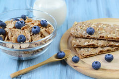 Crispbread and cereal with blueberry and milk on a wooden background Royalty Free Stock Images