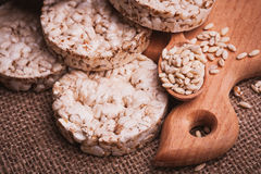 Crispbread, cereal crackers and wooden spoon with Royalty Free Stock Images