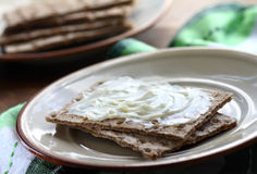 Crispbread and cheese. Close up of crispbread slices with cheese spread Royalty Free Stock Image
