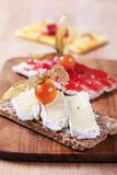 Crispbread with cheese and jam Royalty Free Stock Photo