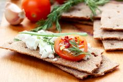 Crispbread with cheese and vegetables stock image