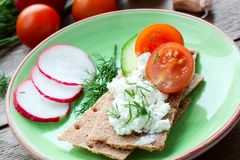 Crispbread with cheese and vegetables Stock Photos