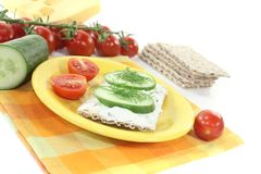 Crispbread with cream cheese and cucumber Stock Image